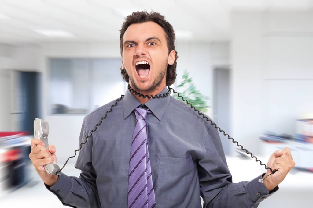 Angry office worker choking himself with his phone cord